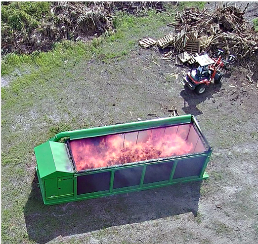 Air Burners Model S-327 in Full Operation at a Wood Waste Collection Site